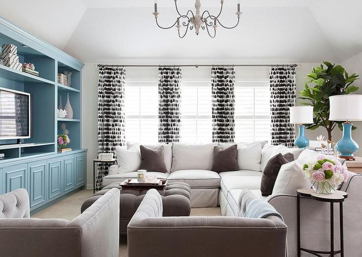 White and brown living room features a sofa table topped - Turquoise white and brown living room ...