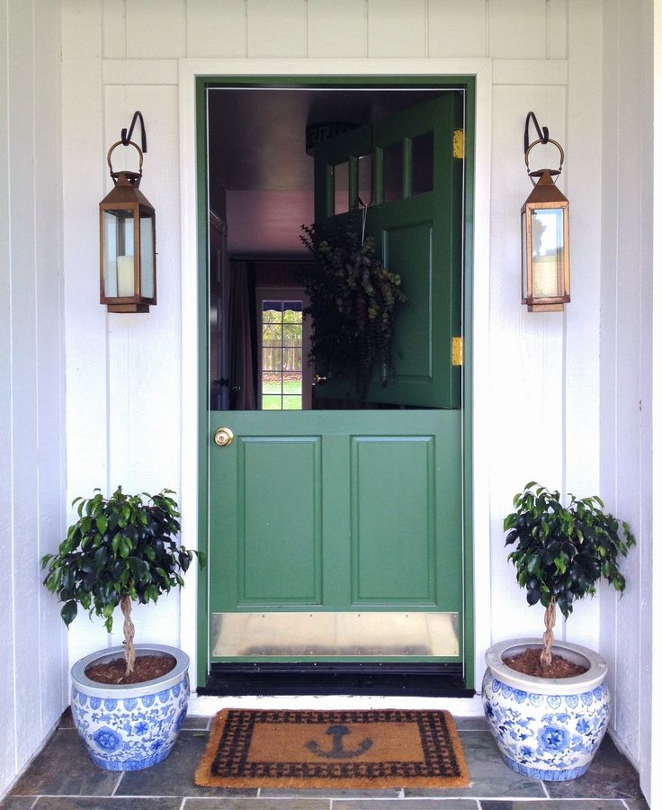 green front door, blue and white planters