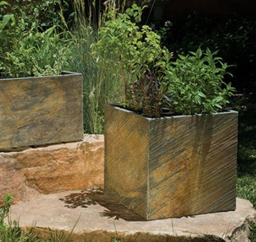 DIY- You can buy 5 slate, or limestone, or travertine tiles for about a dollar or two each...glue them together into cube planter boxes.
