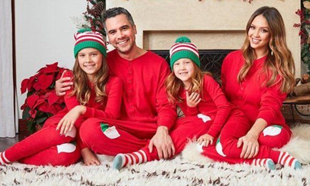 On Sunday, pregnant Jessica Alba posed in matching pajamas with her husband Cash Warren and their two daughters, Honor Marie, nine, and Haven Garner, six, for their family holiday card.