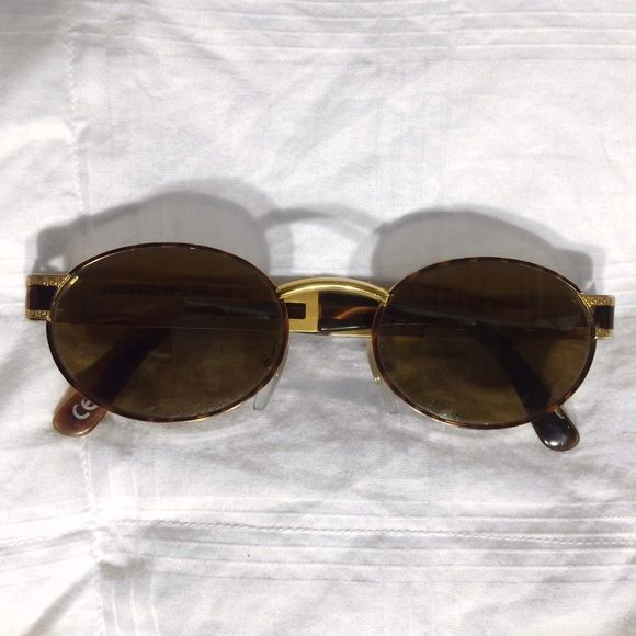 VERSACE Vintage 90s Sunglasses READ DESCRIPTION! (on Ⓜ️)  100% Authentic!   Gianni Versace 1990s Vintage Sunglasses Model: S68  Color: 55M  Perfect Condition!  Both frames and lenses are like new! SOLD OUT everywhere and are EXTREMELY RARE  Do NOT complain about pricing. They are not going for any less on ëbay or any other website.   *comes with only the sunglasses. No Box.   **Willing to träde ONLY for multiple lululemon items. Otherwise only looking to sell Versace Accessories Sunglasses