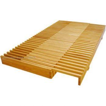 Lit extensible en bois massif (hêtre) lamellé et vernis. Designer: Alain Tavès, éditeur: Sentou