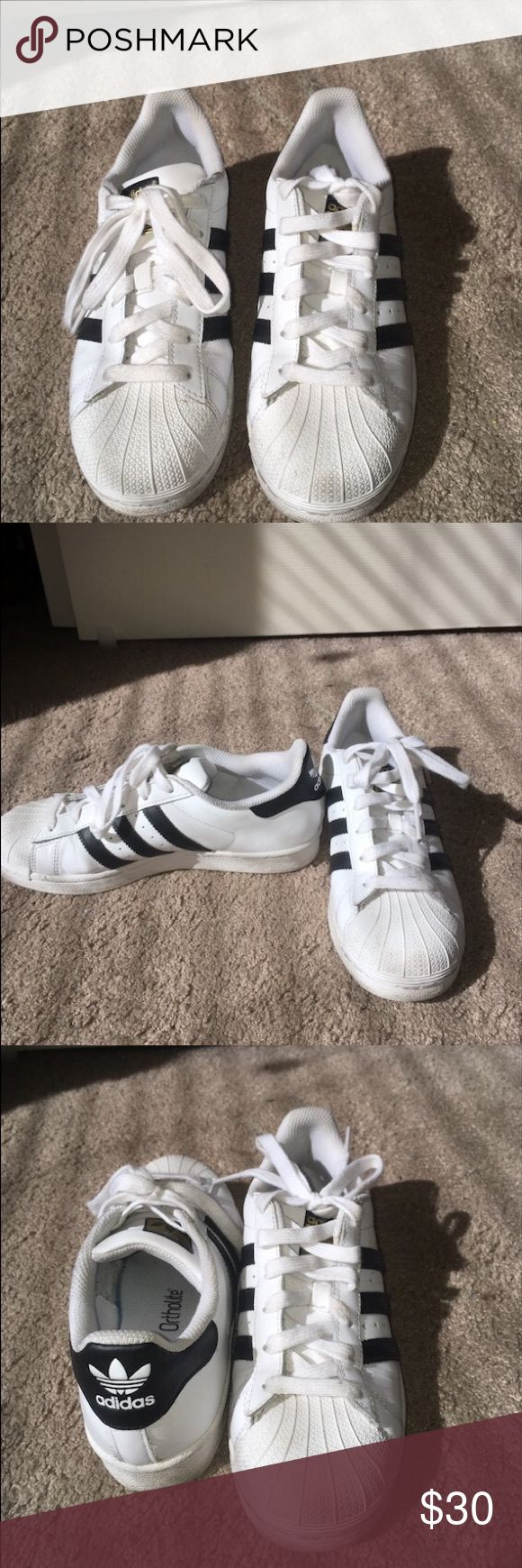 Adidas Superstars Black stripes on white shoes, classic style and popular. Adidas Shoes Sneakers