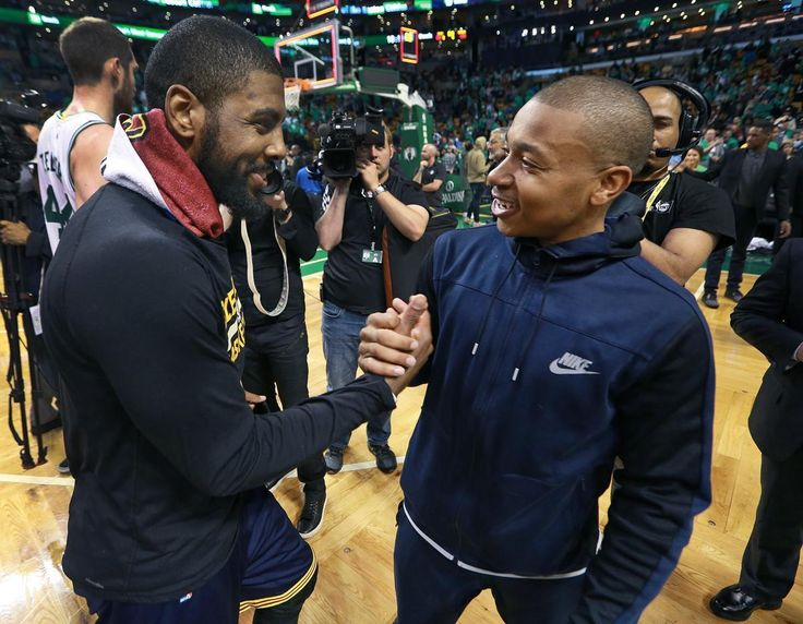 Boston, MA May 25, 2017: After the Cavaliers series clinching victory, injured Celtics guard Isaiah Thomas (right) came onto the floor, here he exchanges a hand with Cleveland's Kyrie Irving (left). The Boston Celtics hosted the Cleveland Cavaliers for Game Five of their NBA Eastern Conference Finals playoff series at the TD Garden (Globe Staff Photo/Jim Davis)