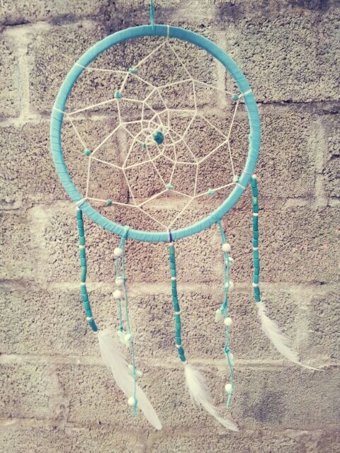 handmade dreamcatcher using ribbon cotton curtain bands ,embroidery thread, beads ,craft paper thread , sea shell flowers and feathers