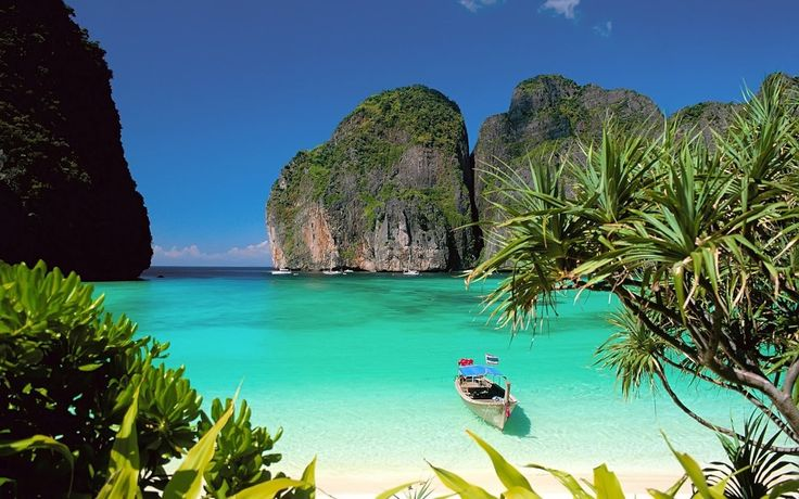 "Maya Bay, Phi Phi Leh Island ~ Thailand. Ever since I saw the movie ""The Beach"" I've dreamed of this place. The white sand, the turquoise water and those huge rocks. Stunning."