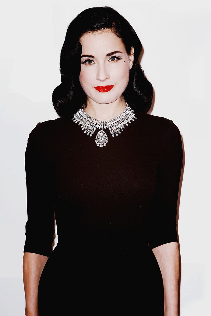 Take a page out of Dita Von Teese's book, sexy can be modest / Black dress / rhinestone collar