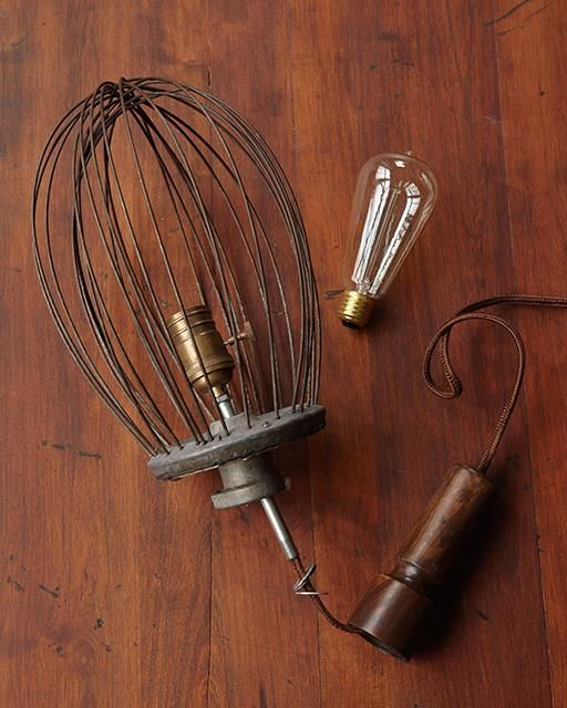 Upcycled Whisk Lamp - I found this old industrial whisk at the huge Brimfield Flea market this summer. It just screamed to be used for something cool. So with a lamp-kit and a few tools I turned it into a hanging lamp. Perfect for the kitchen!