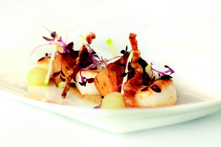 Crispy pork belly and scallops with a micro leaf salad