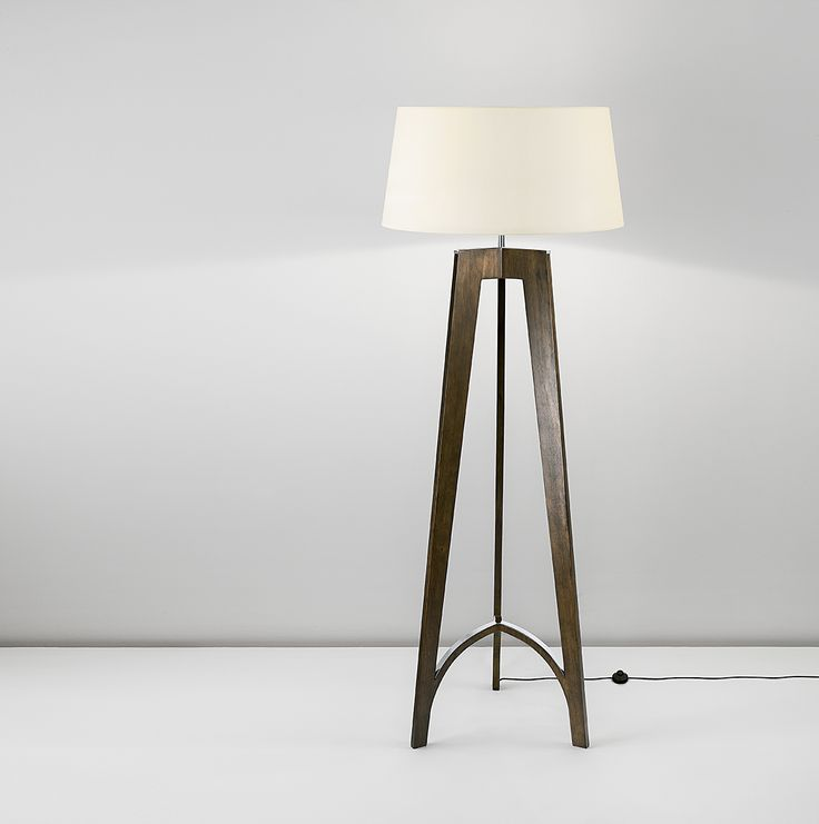 Floor stand with curved tripod base in walnut wood