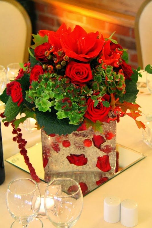 Huge Glass Cube Topped With Red Amaryllis Rose Hips Roses And Hydrangeas Blue Wedding FlowersRuby