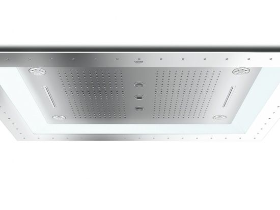 """AquaSymphony is part of the modular Rainshower F-Series 40"""". The spacious element is mounted to the ceiling; it measures more than one metre at its widest point. Various spray patterns from a rain curtain and cold water mist nozzles to the massaging Bokoma jet meet the users' individual needs. In addition, innovative water, light and music effects can be selected. The amount of water is evenly distributed to all active nozzles. A chrome finish ensures the longevity of the product as well..."""
