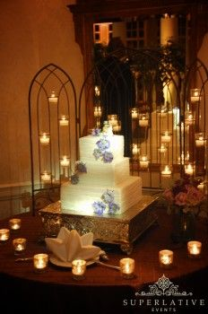 Beautiful cake with spotlight surrounded by candles. Is it real? #LightTheCake @Lauren Thompson Uplights