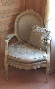 I fell in love with this chair.  I can picture two of these chairs in my bedroom with a round accent table between them.