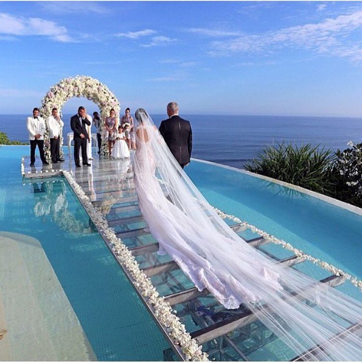 "Beautiful ocean seaside wedding  Aisle is glass over water of infinity pool.  Location: Tropical island in Caribbean or pacific ocean... maybe Maldives or Hawaii  ""Tag your love ❤️ 