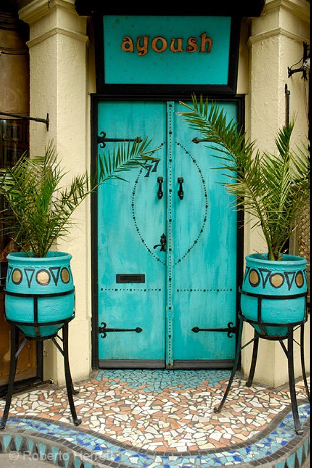 Turquoise door to Ayoush - North African members restaurant in London, England. - photo by Roberto Herrett