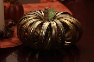 The CSI Project gives a great tutorial on making a canning lid pumpkin!