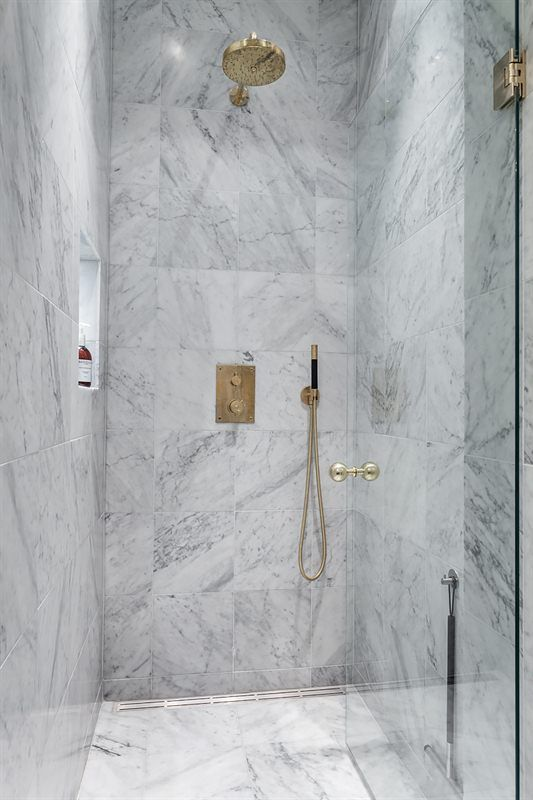 Interior marble brass shower bathroom