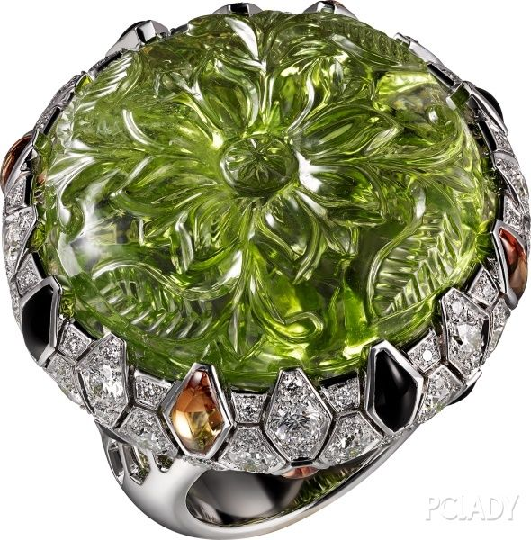 "CARTIER. ""Green Anaconda"" Ring - white gold, one 47.66-carat carved peridot, orange sapphires, onyx, brilliant-cut diamonds. #Cartier #CartierMagicien #HauteJoaillerie #FineJewelry #Peridot #OrangeSapphire #Onyx #Diamond"