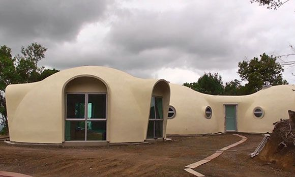 this dome house is made of polyurethane foam sandwiched between glass-fiber reinforced concrete walls.  less material to build, stronger and more energy efficient than traditional construction.