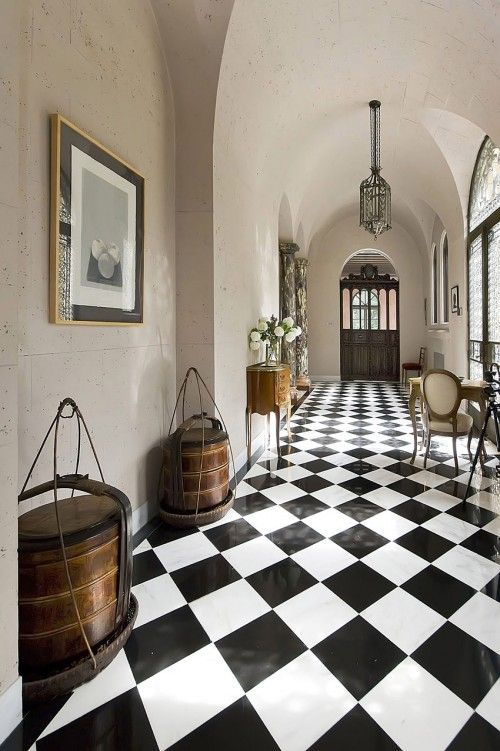 Interiorstyledesign Entry Hallway With Arched Barrel Ceilings And A Classic Black And White Checkerboard Tile