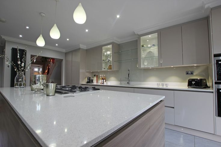 Soft understated tones of gloss Cashmere kitchen units.