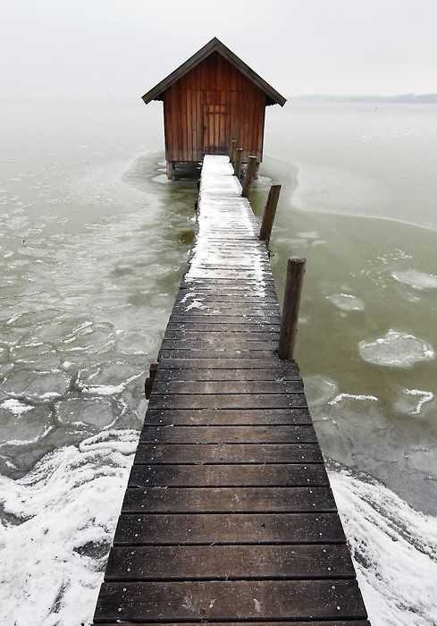 Ice covers the surface of Lake Ammersee, at Stegen am Ammersee, German, January 2010 -  by Johannes Simon