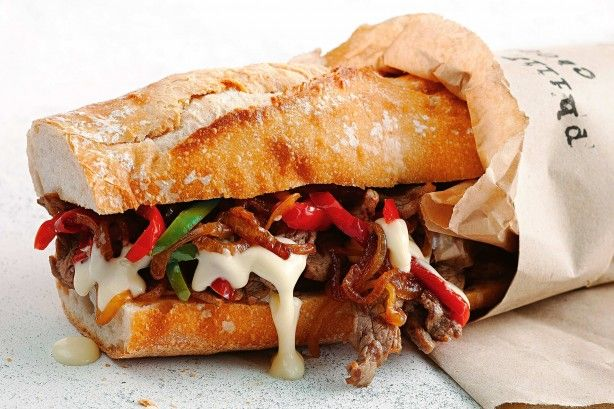 This Philly steak sambo is loaded with succulent steak, sweet onions and lots of oozy cheese.