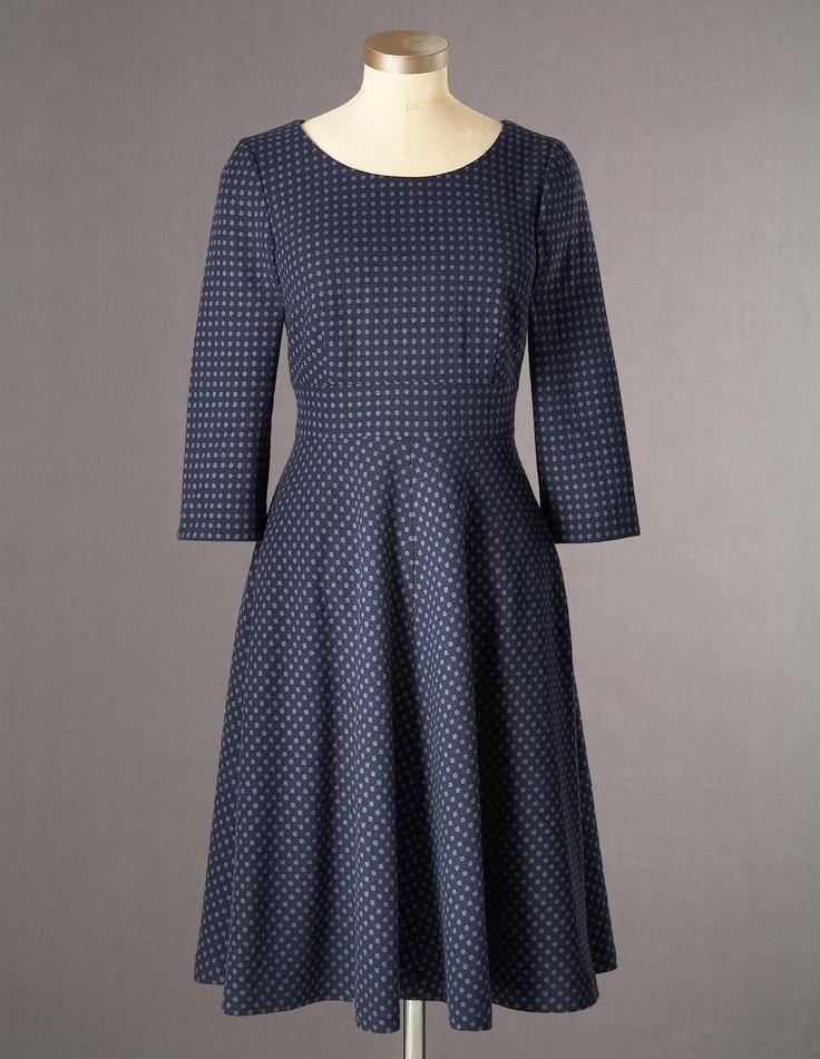 With it's woven-in spots and flattering full skirt, here is our Kate Dress in navy.