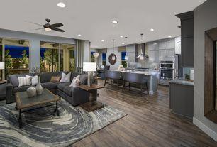 Transitional Living Room with High ceiling, Carpet, Gemini Gray Area Rug, Hardwood floors, Ceiling fan, flush light