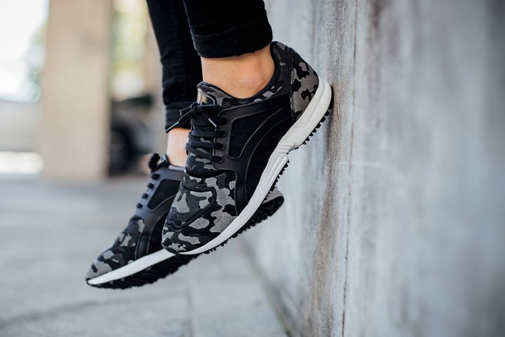The adidas Racer Lite is covered in a camouflage motif in shades of Black and White for its latest iteration this season.