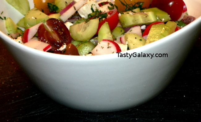 Easy Greek Salad Recipes, this delicious Greek Salad Recipe comes together in no time! Just combine the ingredients, and dress with our very simple Greek Salad Dressing, made with just a few ingredients! You will love this delicious Greek Salad #greek #olive #onion #tomatoes #vegetarian #vegetables #vegetarianrecipes