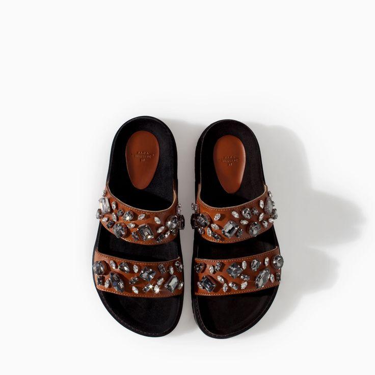 http://www.zara.com/ru/ru/распродажа/trf/обувь/сандалии-на-низком-каблуке-био-кожаные-с-украшениями-c542332p1794647.html