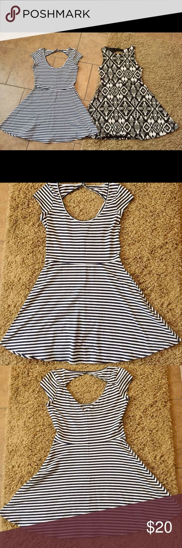 AMERICAN EAGLE/ VICTORIA SECRET DRESSES AMERICAN EAGLE DRESS IS SIZE MED WHITE AND NAVY BLUE STRIPED - VICTORIA SECRET DRESS IS BLACK AND WHITE AND IS ALSO A MED BOTH WE'RE WORN ONCE Victoria's Secret Dresses Midi