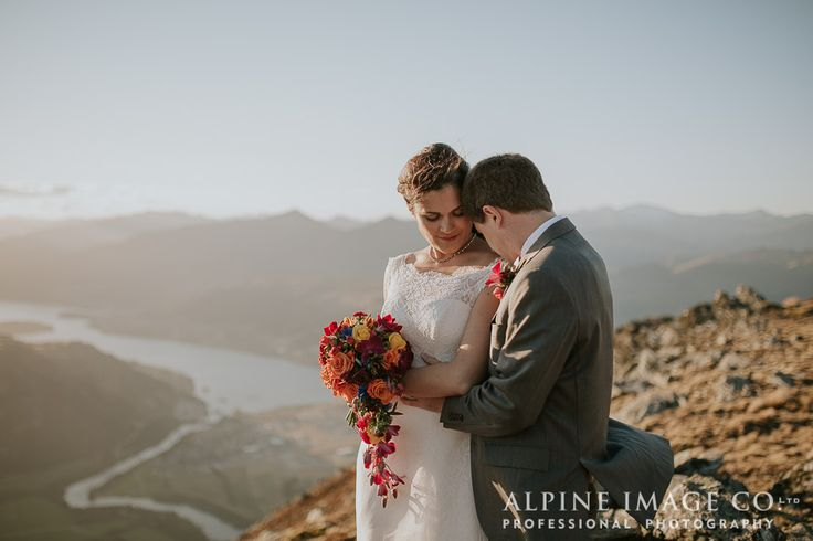 Stolen moments on your wedding day... what better way to see Queenstown, New Zealand than a helicopter ride to The Remarkables. Photography by Alpine Image Company.