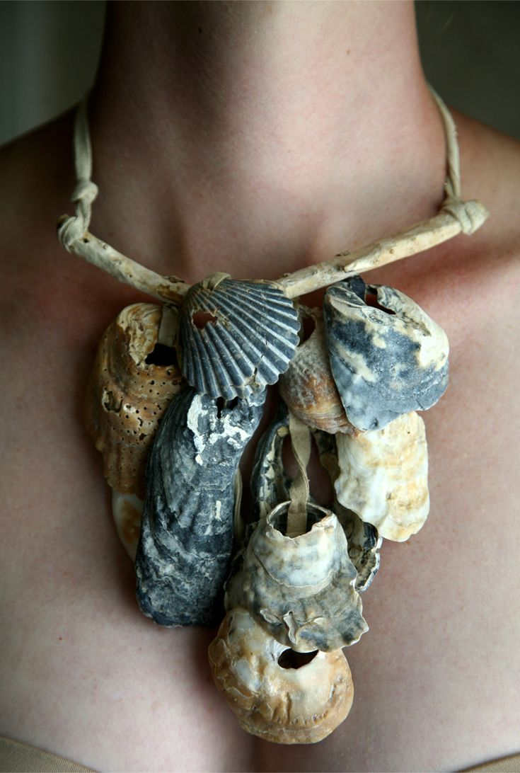 Necklace | Dawn Wain.  Using elements of nature to enhance one's well-being is the inspiration for Wain's line of wearable art. The use of hand carved woods and bone carvings, combined with gemstones, crystals, fossils and seashells are just some examples of what each raw element beings to the mix