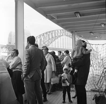Migrants take a first look at Sydney as the ship docks near the harbour bridge, 1969. Department of Immigration and Multicultural and Indigenous Affairs. NAA: A12111, 1/1969/4/51