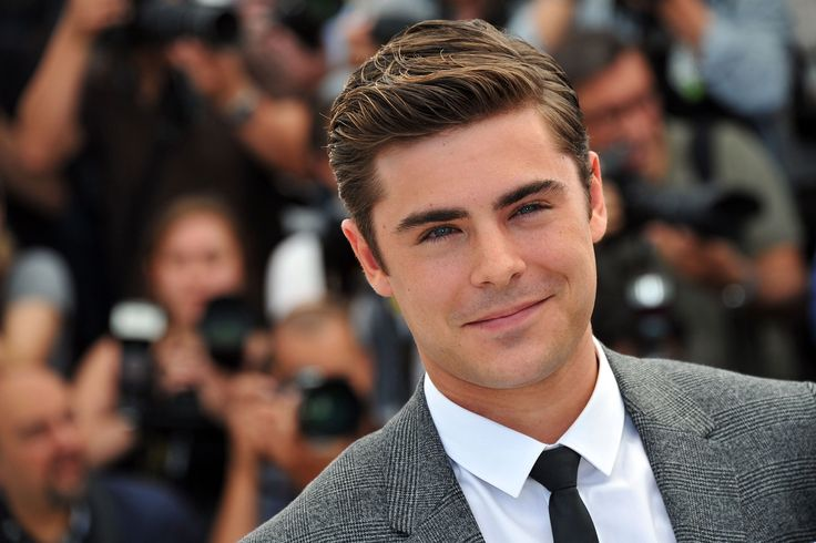"""Zachary David Alexander """"Zac"""" Efron is an American actor and singer. He began acting professionally in the early 2000s, and rose to prominence in the late 2000s for his leading role in the High School Musical franchise.  Born: October 18, 1987 (age 29 years), San Luis Obispo, CA Height: 5′ 8″ Upcoming movies: Baywatch, The Greatest Showman Siblings: Dylan Efron Parents: David Efron, Starla Baskett"""