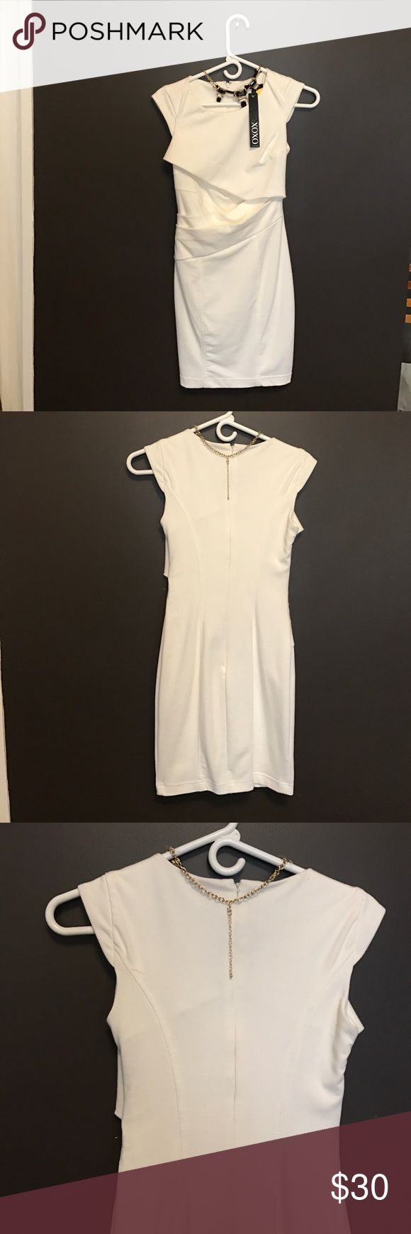 Sexy White Bodycon Dress Flattering and curve hugging! Size 1/2 by XOXO. NWOT but price sticker has been removed. Perfect for a night out! Dresses