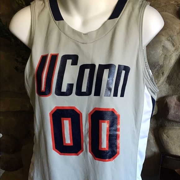 NWT Nike Women's U Conn basketball jersey, size M Brand new with tags, this Nike Dri-Fit jersey will thrill your favorite U Conn fan.  It is a women's size medium. Get this now for a fraction of retail and have it under the tree just in time for the most exciting games! Nike Tops