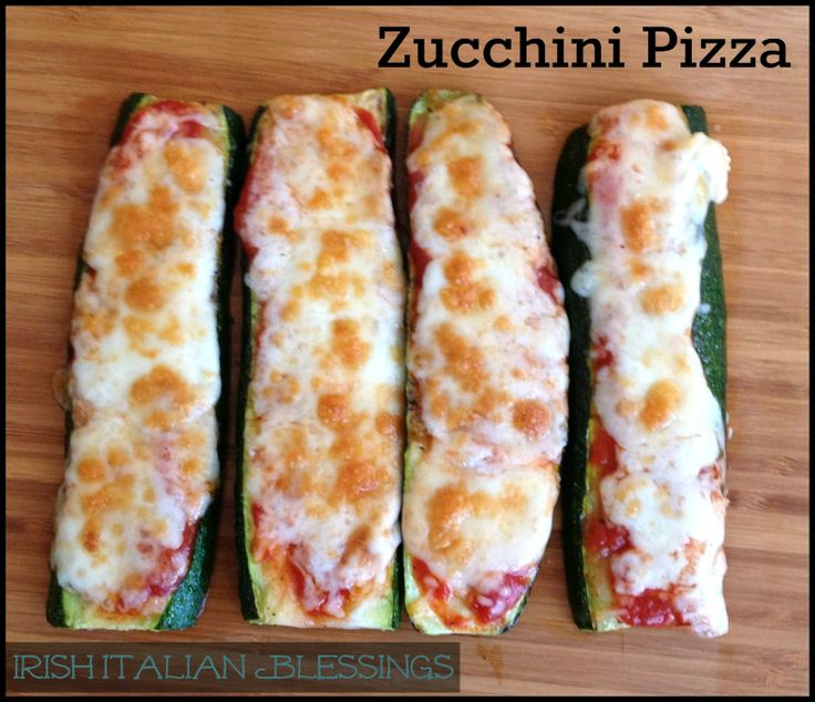We love zucchini pizzas. Here, she's split them long-ways so they're fun to snack on…like zucchini pizza fingers! Red sauce and melted cheese makes them just perfect.