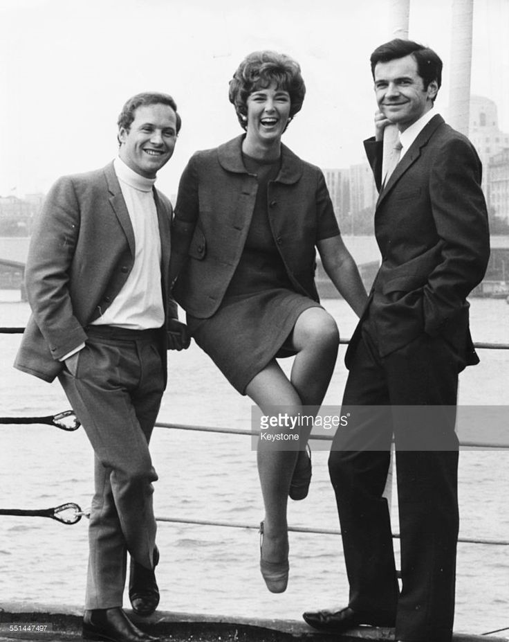 Portrait of Thames TV announcers (L-R) David Hamilton, Sheila Kennedy and Philip Elsmore on the bank of the River Thames, London, July 20th 1968.