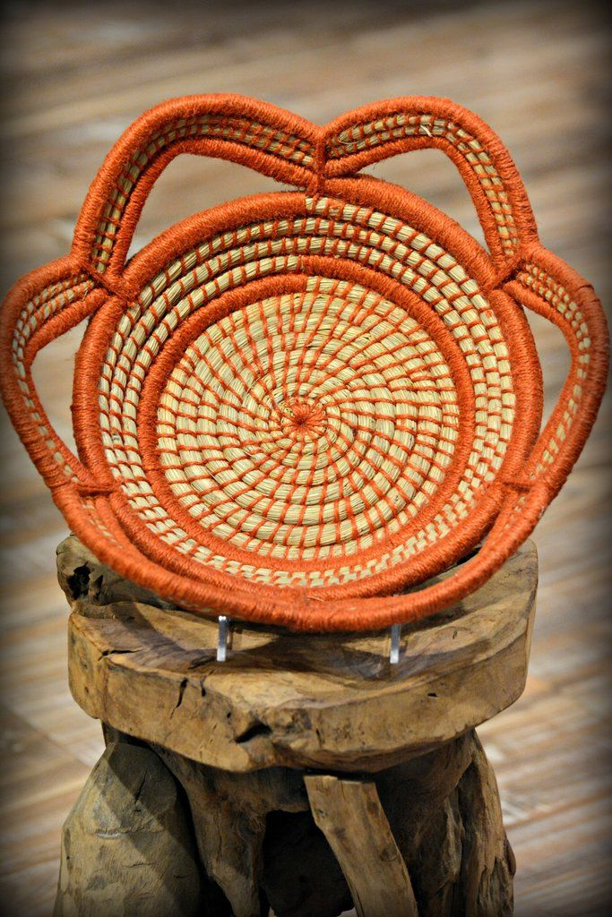 Kaisa grass and jute are beautifully combined in our ethically made Orange Scalloped Woven Basket. Kaisa grass is a sustainable and abundant fast-growing grass in Bangladesh. A wonderful resource for