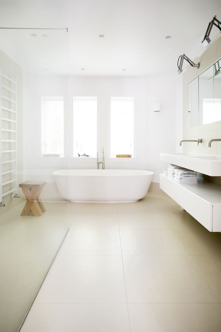 Bathroom project by www.sjartec.nl Sand colour marble tiles with mat white freestanding bath.