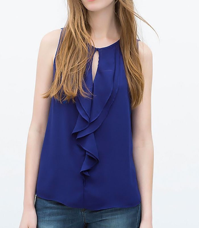 Sleveless blouse with ruches details