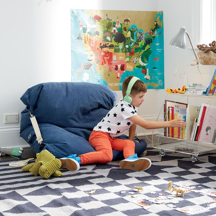 Interior Design Idea - 11 Essentials For Kids Homework Stations // Add some comfort -- Include a pouf or bean bag chair somewhere close to the study area to provide a cozy spot for you kids to read in and they'll be much more likely to enjoy their books.
