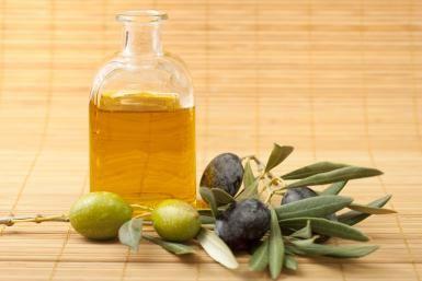 Olives and olive oil in bottle - FernandoAH / Getty Images