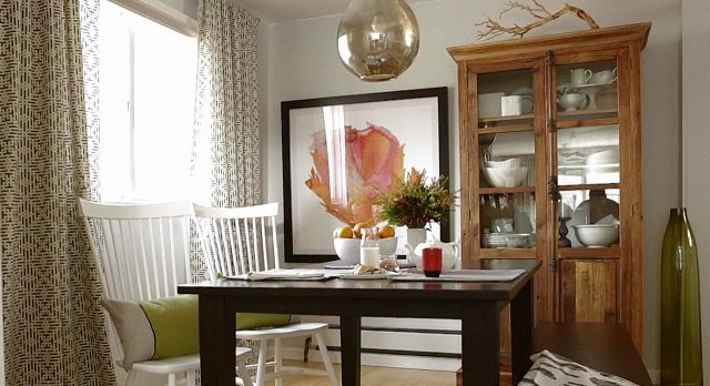 Make a small dining room feel larger.  Ingredients: one large picture, curtains to the ceiling, tall hutch, and add simple details such as branch on top of shelf.  Picture Credit Better Homes and Gardens