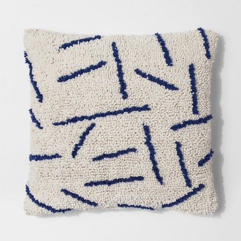 Add some fun to your home decor with this Textured Throw Pillow from Project 62™. This pillow features a clean white background with dark blue accent lines that add just the right amount of color with a hint of nautical flair. The texture adds comfort while the design adds modern style to this classic color combination.<br><br>1962 was a big year. Modernist design hit its peak and moved into homes across the country. And in Minnesota, Target was born — with the ...