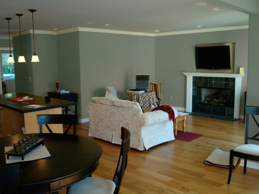 Devine Almond makes gold hues in    wood richer by making it redder.  Note:  the black fireplace.